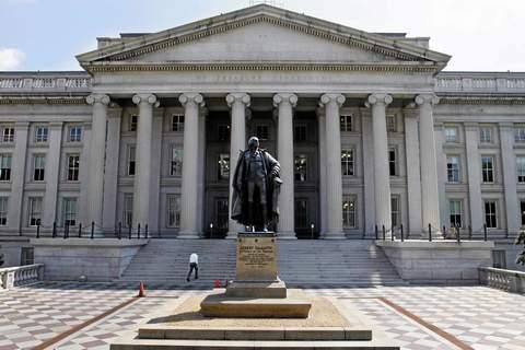 A statue of former Treasury Secretary Albert Gallatin outside the Treasury Building in Washington