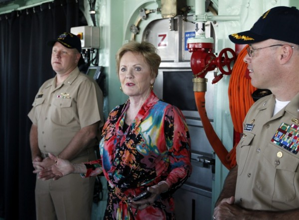 Rep. Kay Granger, R-Fort Worth, flanked by naval officers on the bridge of the Navy's newest vessel, the Fort Worth, on September 20, 2012