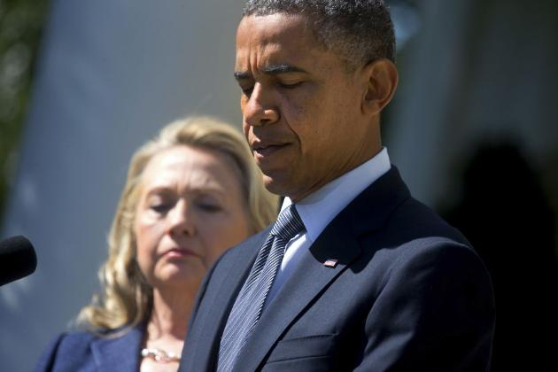 President Obama with Hillary Clinton in background