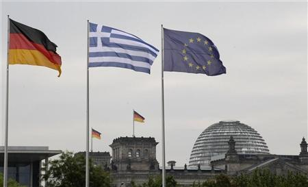 The flags of Germany, Greece and European Union flutter in the wind before a meeting between German Chancellor Angela Merkel and Greek Prime Minister Antonis Samaras in Berlin, August 24, 2012. Credit: Reuters/Tobias Schwarz