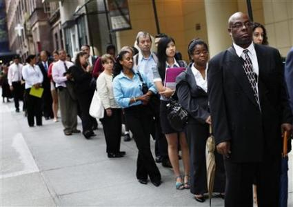 In this Reuters photo, people wait in line at an August 2011 job fair in New York.