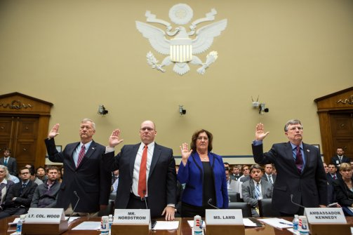 (From left to right) Lt. Col. Andrew Wood of the Utah National Guard, Eric Nordstrom, Regional Security Officer at the U.S. Department of State, Charlene R. Lamb, Deputy Assistant Secretary for International Programs at the U.S. Department of State, and Ambassador Patrick Kennedy, Under Secretary for Management at the U.S. Department of State, are sworn in before testifying on Capitol Hill on October 10, 2012 in Washington, DC. The hearing before the House Oversight and Government Reform Committee focused on the security situation in Benghazi leading up to the September 11 attack that resulted in the assassination of U.S. Ambassador to Libya J. Christopher Stevens. (Brendan Hoffman / Getty Images)