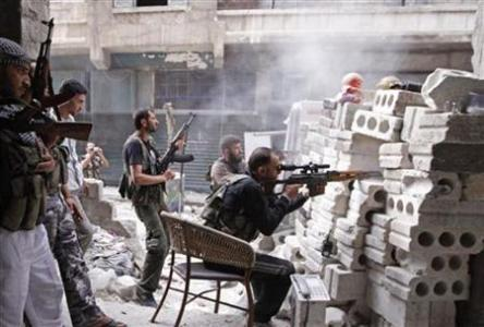 In this Reuters photo, members of the Free Syrian Army in Aleppo City, Oct. 11, 2012.