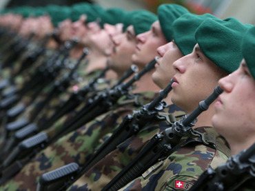 Members of Switzerland's Army Forces (Reuters / Thomas Hodel)