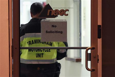 A Framingham Motorcycle Unit officer stands by while federal agents search New England Compounding Center in Framingham, Massachusetts October 16, 2012.Credit: Reuters/Dominick Reuter