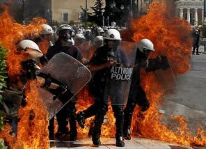 A fire bomb explodes among riot police during clashes in Athens, Greece, on September 26, 2012