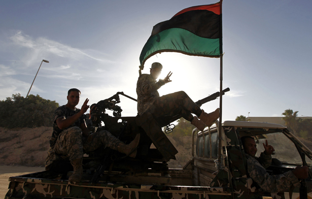 Libyan security forces gesture as they head to a compound which had been taken over by an armed group in Tripoli September 23, 2012. Credit: Reuters/Anis Mili Getty Images