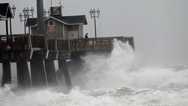 Large waves generated by Hurricane Sandy crash into Jeanette's Pier in Nags Head, North Carolina. Credit: AP/Gerry Broome