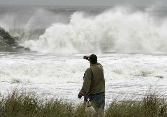 A man takes a photograph as seas build off New Jersey. Sandy will strike the US East Coast in the evening of Monday, Oct 29, 2012. Credit: Reuters