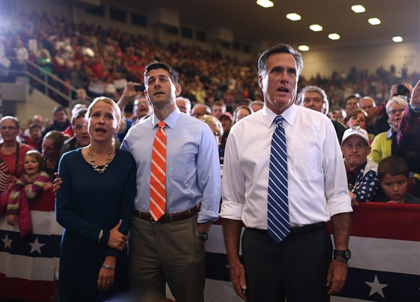 Mitt Romney and Paul Ryan sing along with Janna Ryan as the Oakridge Boys perform during a campaign rally at the Marion County Fairgrounds in Marion, Ohio on Sunday, Oct 28, 2012. Credit: Getty Images