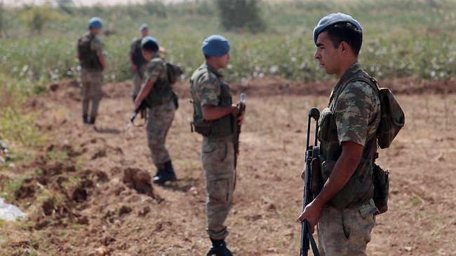 In this AP file photo, Turkish commandos stand near the Turkey-Syria border in Akcakale, Turkey, after Ankara authorized military action in early October 2012.