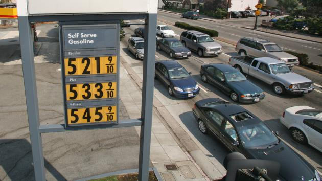 In this UPI photo, a price board advertises gas above five dollars a gallon at a Shell station on El Camino Real in San Mateo, California.