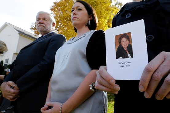 In this AP photo, George Cary and daughters at a memorial service in Howell, Michigan, Tuesday for his wife, Lilian Cary, 67 years old, whose death was linked to fungal meningitis from steroid injections.