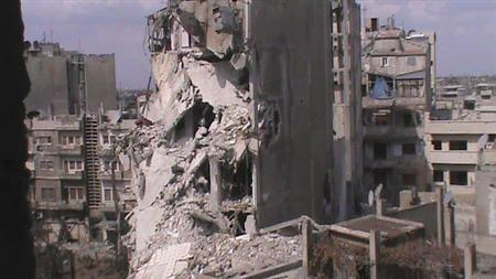 Reuters photo: Buildings damaged in the Turkey-Syria conflict.