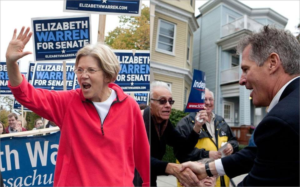 Democratic challenger Elizabeth Warren and Senator Scott Brown marched through East Boston on Sunday as part of the annual Columbus Day parade, held in advance of the Monday holiday.