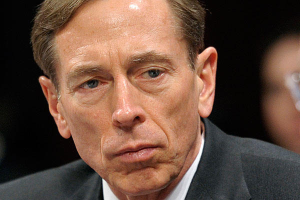 IMAGE: This February 2012 file photo shows CIA Director David Petraeus testifying on Capitol Hill in Washington. Petraeus resigned because of an extramarital affair. Credit: Cliff Owen/AP/File