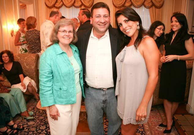IMAGE:  Jill Kelley, 37, (right) is believed to be the 'mystery woman' who blew the lid off former CIA Director David Petraeus' career-ending affair. She is seen here with Petraeus' wife Holly Petraeus (left) and her husband Scott Kelley at a party. Credit: Stephen Theriault