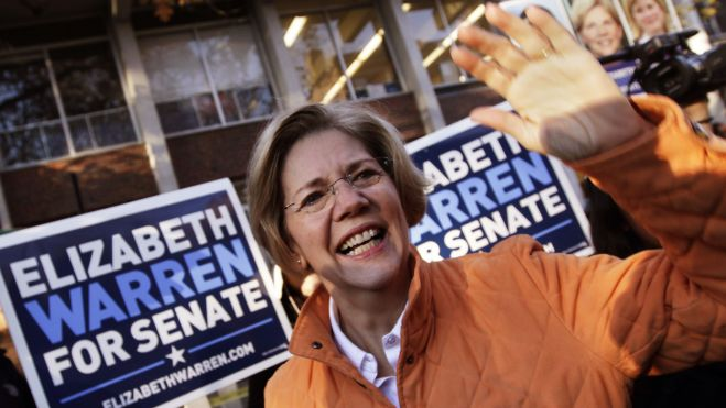 IMAGE: November 6, 2012: Democratic candidate for Massachusetts Senate Elizabeth Warren waves to supporters before voting in Cambridge, Massachusetts. (REUTERS)
