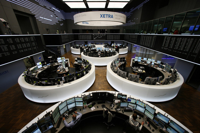IMAGE: Traders work on the floor of the Frankfurt Stock Exchange in Frankfurt. Photographer: Ralph Orlowski/Bloomberg
