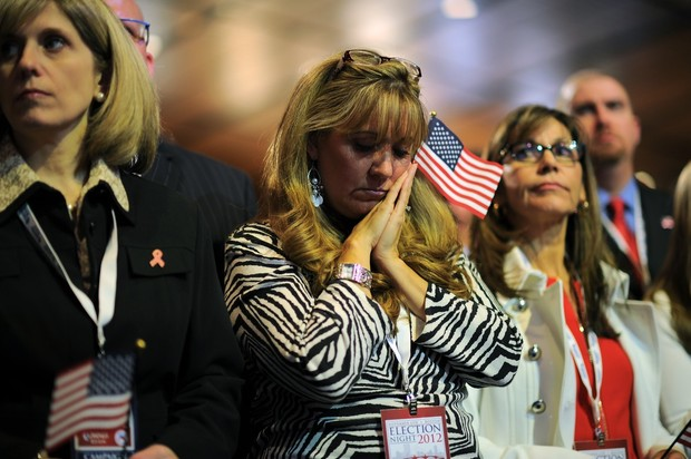 IMAGE: Supporters of Republican presidential candidate Mitt Romney react to results on election night November 6, 2012 in Boston Massachusetts. US President Barack Obama was re-elected Tuesday, November 6, 2012, television networks projected -- only the second time in several decades that a Democrat has won a second term in the White House. Credit: Getty Images