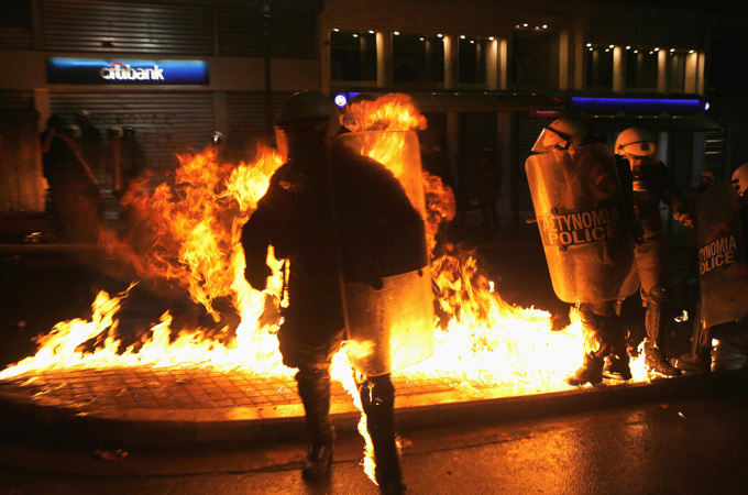 IMAGE: Petrol bombs exploded next to riot police during the demonstration in central Athens [Reuters]