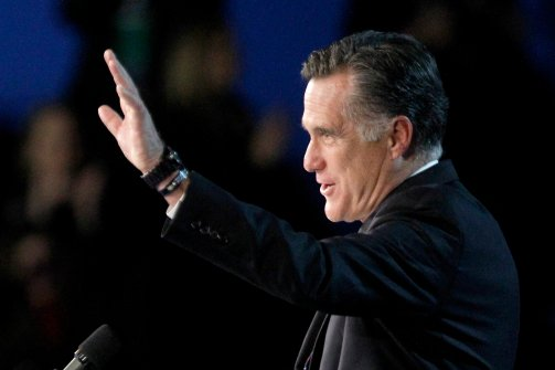 IMAGE: Republican presidential candidate and former Massachusetts Gov. Mitt Romney waves to supporters during his election night rally, Wednesday, Nov. 7, 2012, in Boston. (Mary Altaffer / AP Photo)